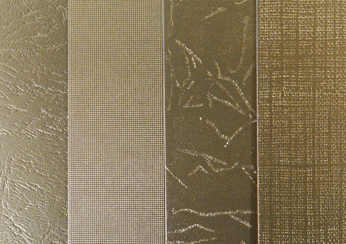 (写真2)様々なエンボスの柄。左から順に、皮紋、絹目、石目、キャンバス目。 | 第6回「デザインエッセンスとしてのエンボス加工」 - 池ヶ谷紙工所 | 活版印刷研究所