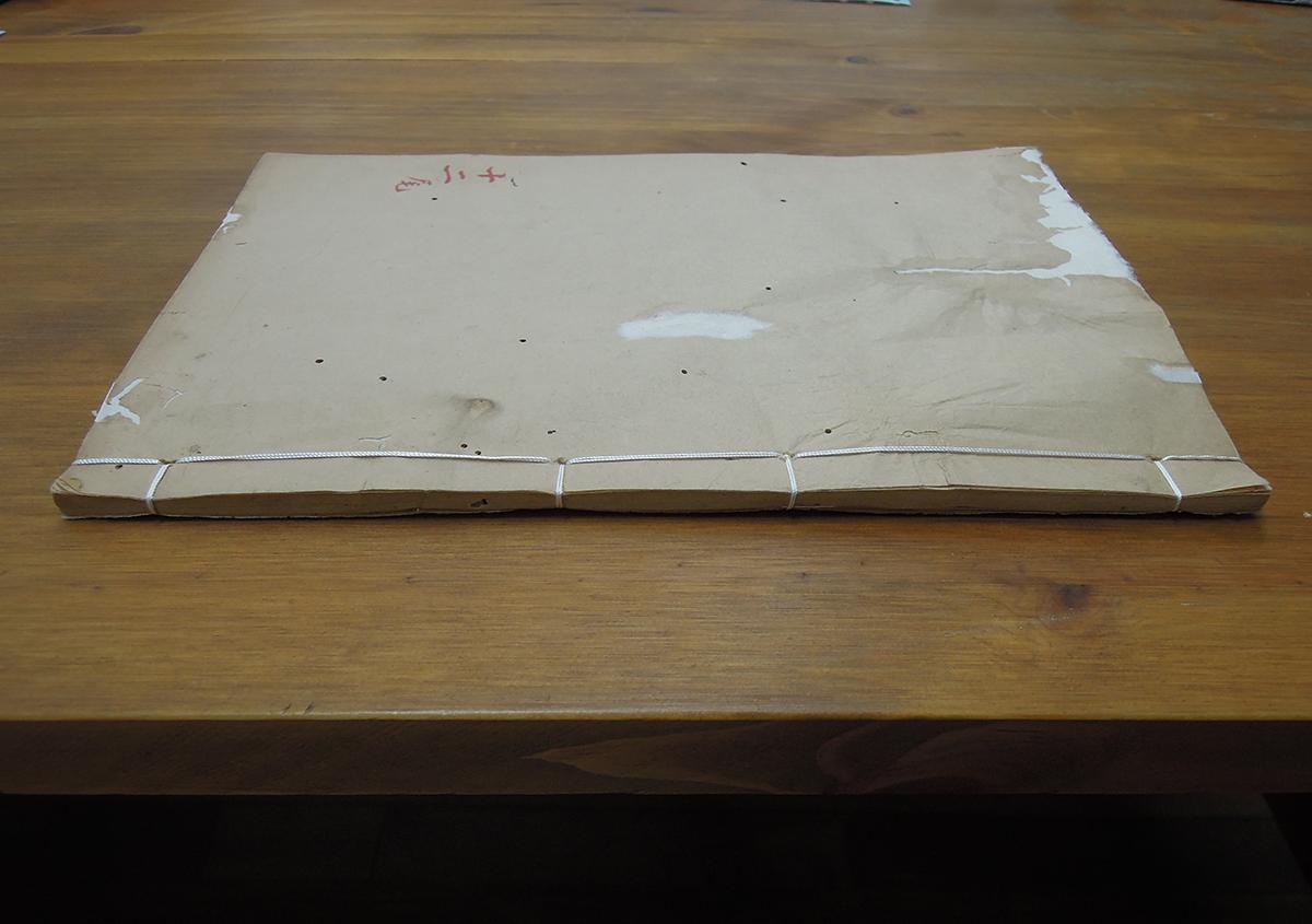 (写真7)表紙裏打ち、綴じ直しした巻<   ある漢籍の修理 - 京都大学図書館資料保存ワークショップ   活版印刷研究所